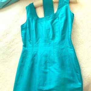 Silk turquoise blue cocktail dress with belt.